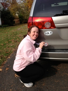 Me with my shiny new medal and my half marathon car magnet.